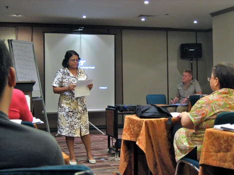 Workshop participant Minoli presents her idea during an exercise as Tommy (in background) listens.